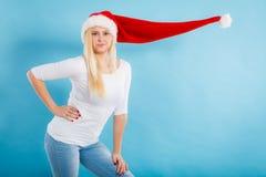 Woman wearing windblown long Santa hat Stock Photo