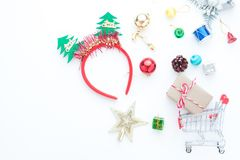 Christmas accessories and shopping cart with gift boxes on white Stock Images