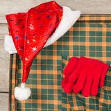 Christmas Santa Claus Caps and Knitting Strips Golfs in Open Wooden Suitcase. Christmas accessories in a suitcase for travel Stock Images