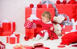 Christmas activities for toddlers. Christmas gifts for toddler. Things to do with toddlers at christmas. Little baby. Girl play near pile of gift boxes. Family stock image