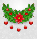 Christmas adornment with balls, holly berry, pine and poinsettia Royalty Free Stock Image