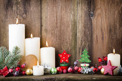 Christmas Advent candles with festive decor. Royalty Free Stock Photos