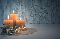 Christmas advent candles with golden decorations. Three burning candles with golden Christmas decorations on rustic neutral background. Happy Third Advent! This Stock Images