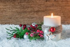 Christmas or Advent decoration with candle and snow stock image