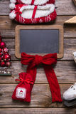 Christmas or advent wooden sign with red decoration for a greeti Royalty Free Stock Images
