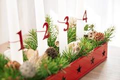 Christmas advent wreath on table, third advent in focus. Christmas advent wreath closeup with decoration on table, third advent candle in focus Stock Photos