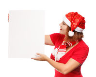 Christmas advertisement. Beautiful young woman in christmas suit holding advertisement isolated on white background Stock Images