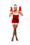 Christmas afro american woman wearing a santa hat smiling Stock Photos