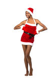 Christmas afro american woman wearing a santa hat smiling Royalty Free Stock Photography