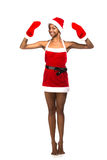Christmas afro american woman wearing a santa hat smiling Stock Photo