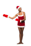 Christmas afro american woman wearing a santa hat smiling Stock Image
