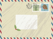 Christmas airmail. Airmail envelope with festive stamps and text box Royalty Free Stock Photography