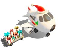 Christmas airplane and presents ready to be delivered Royalty Free Stock Images