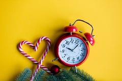 Christmas alarm clock  and lolipop Stock Photos