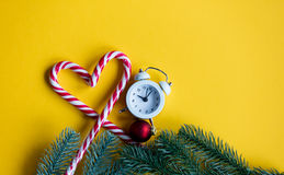 Christmas alarm clock  and lolipop Royalty Free Stock Photo