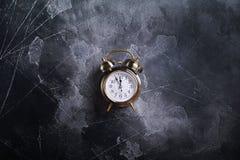 Christmas Alarm Clock on Vintage Darken Time Concept stock photography
