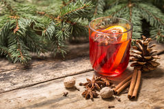 Christmas alcoholic drink on wooden background Royalty Free Stock Photos