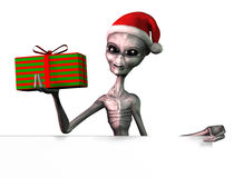 Christmas Alien with Sign Edge - with clipping path. 3D render of a Christmas Alien with the edge of a blank sign Royalty Free Stock Photography