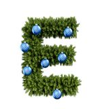 Christmas alphabet ABC character letter E font with Christmas ball. Christmas tree branches capital letters decoration type with stock illustration