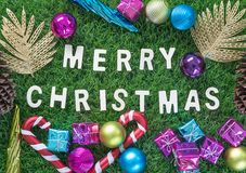Christmas alphabet and decoration on green grass Stock Photography