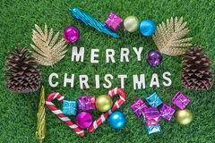 Christmas alphabet and decoration on green grass Stock Photos