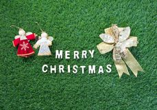 Christmas alphabet and decoration on green grass. Celebration of New year and Christmas, Top view Christmas alphabet and decoration on green grass background Royalty Free Stock Image
