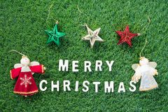 Christmas alphabet and decoration on green grass. Celebration of New year and Christmas, Top view Christmas alphabet and decoration on green grass background Royalty Free Stock Photos