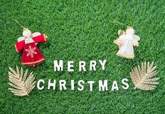 Christmas alphabet and decoration on green grass. Celebration of New year and Christmas, Top view Christmas alphabet and decoration on green grass background Stock Image