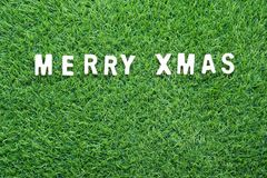 Christmas alphabet on green grass. Celebration of New year and Christmas, Top view Christmas alphabet on green grass background Stock Photo