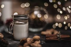 Free Christmas And New Year Decoration Background With Round Bokeh Garland, Cinnamon, Cookies, Cones, Nuts And Candle In Cup Royalty Free Stock Images - 133413779