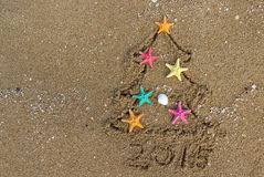 Christmas And New Year On The Beach Stock Images