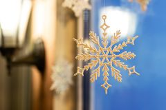 Free Christmas And New Year Ornament Decoration Snowlake Handed Near Window With Warm Lamp Lattern On Background. Winter Holidays Card Royalty Free Stock Photo - 131939425