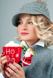 Christmas And New Year. Woman In Knitted Hat Is Drinking Coffee. Stock Photos