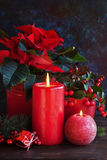 Christmas andles and poinsettia Royalty Free Stock Image