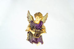 Christmas Angel-1. This is a Christmas ornament of a ceramic angel holding a harp against a light blue 'sky' background. (14MP camera Royalty Free Stock Image