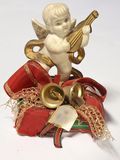 Christmas angel. Small christmas angel  figure with bells and mandolin Stock Photo