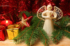 Christmas angel. Praying angel in Christmas tree branches with Christmas red ornaments Stock Images