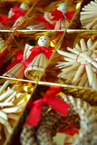 Christmas angel. Gold-red Christmas decoration from straw Royalty Free Stock Image