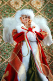Christmas angel. Figurine in red with white feather wings Royalty Free Stock Photos