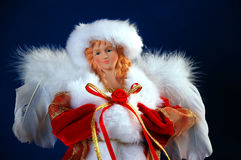 Christmas angel. Figurine in red with white feather wings Royalty Free Stock Photography