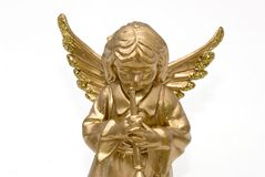 Christmas angel. A golden christmas angel with two gifts royalty free stock image