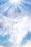 Christmas angel. Christmas concept with white angel over bright sky with stars and rays of Light Royalty Free Stock Photos