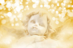 Christmas Angel. A background of golden holiday lights royalty free stock photos
