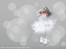 Christmas angel. Decoration against blurry lights background stock images