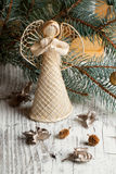 Christmas angel. Figurine on white wooden table Stock Photography