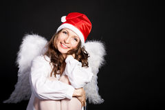 Christmas angel. Against black background Stock Photo