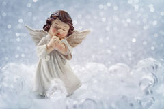 Christmas angel. On silver background royalty free stock photography