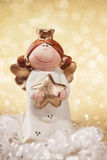 Christmas angel. On golden background Stock Image