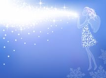 Christmas angel. Blowing away stars and sparks from her palms Royalty Free Stock Photos