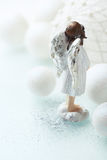 Christmas Angel. Close up of a little christmas angel with white christmas balls Royalty Free Stock Images